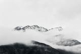 winter landscape of snow mountain peak in fog  - 332244326