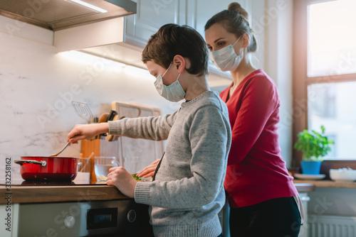 Fotografie, Obraz Family cooking at home during coronavirus crisis