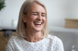 canvas print picture - Happy middle aged blonde woman with healthy toothy smile feeling excited, head shot close up portrait. Attractive mature lady laughing at funny joke, having fun at home, positive emotions expressing.
