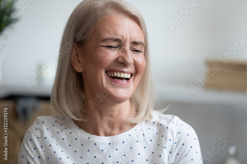 Fotografija Happy middle aged blonde woman with healthy toothy smile feeling excited, head shot close up portrait