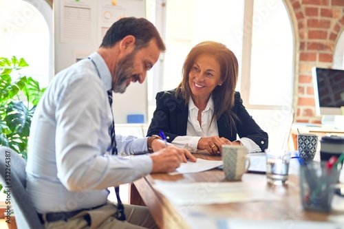 Fotografia Two middle age business workers smiling happy and confident