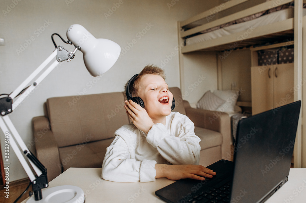 Fototapeta child laugh home school quarantine online technology
