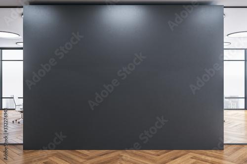 Obraz Blank gray wall in modern office interior. - fototapety do salonu