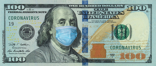 Fototapeta Medical mask on a banknote of 100 dollars, concept of the global financial crisis. Medical mask or surgical mask on american money. COVID-19 coronavirus in USA. Doctor mask protects against COVID-19. obraz