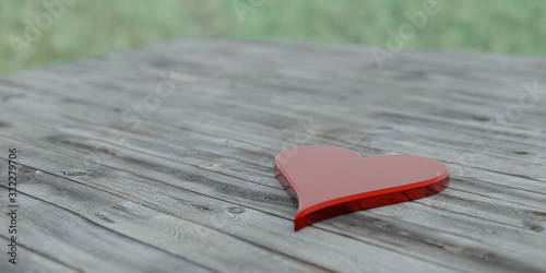 glossy shiny red stone heart on wooden background in sun dawn lighting concept for love 3d illustration render