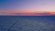 Bright sunset in winter on a snow-covered sea with path. Aerial view.