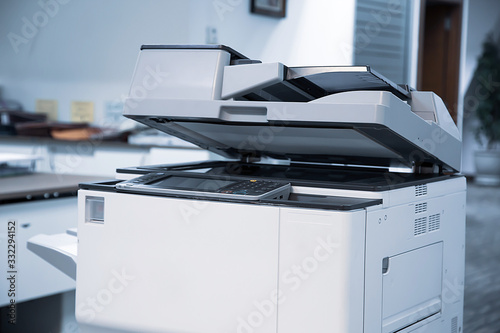 Obraz The photocopier or network printer is office worker tool equipment for scanning and copy paper. - fototapety do salonu