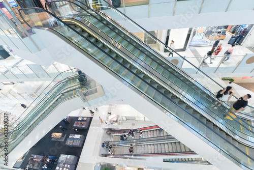 Interior view of escalator in shopping mall Wallpaper Mural