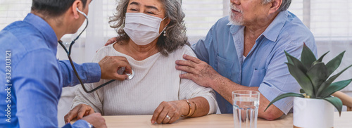 Bnner or web cover of Doctor using stethoscope for auscultate Asian grandparent Canvas Print