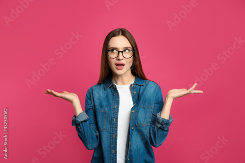 Pensive woman on pink background Wallpaper Mural