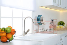 Clean Dishes On Drying Rack In...