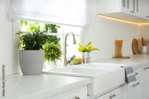 Leinwand Poster Beautiful white sink near window in modern kitchen
