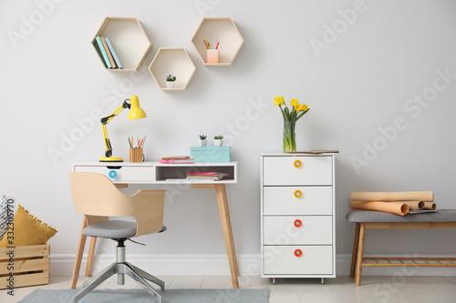 Obraz Stylish room interior with modern comfortable workplace - fototapety do salonu