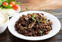 Northern Thai Food, Spicy Minced Pork Salad (Larb Moo Kua) Eating With Sticky Rice And Fresh Vegetables
