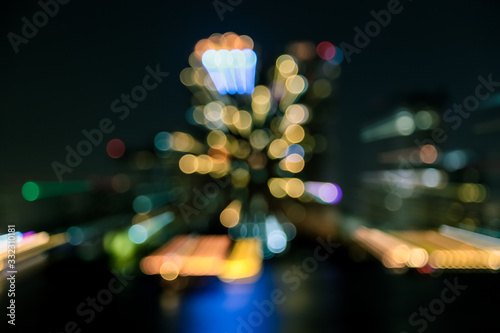 Fototapeta Blur of City at night with light bokeh and water reflection