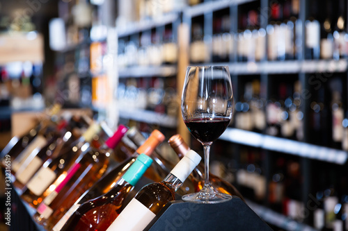 Closeup of red wine glass in wine shop Wallpaper Mural