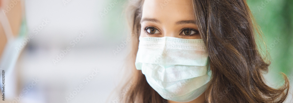 Fototapeta close up face woman wearing medical mask for prevent dust and infection virus.