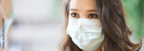 Fototapeta close up face woman wearing medical mask for prevent dust and infection virus. obraz
