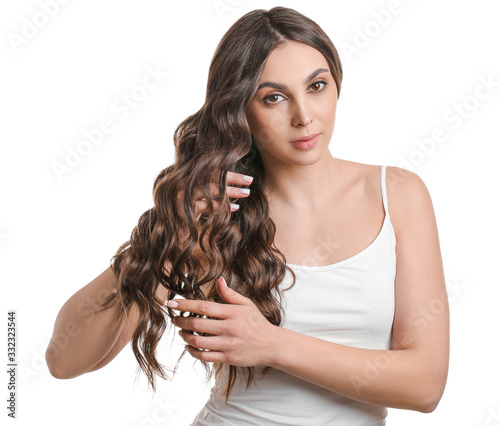 Fotografia, Obraz Young woman with beautiful wavy hair on white background