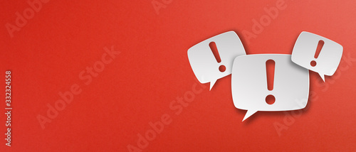 Photo Exclamation mark with speech bubbles on red background