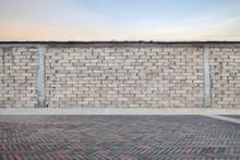 Gray Brick Wall With Empty Brick Pavement