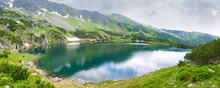 Mountain Lake Under The Craggy Slope In Tatra Mountains