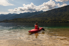 Girl Kayaking In The Bohinj Lake