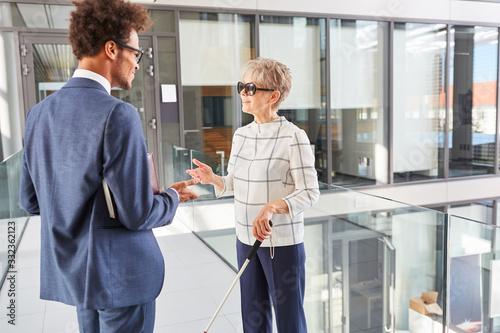 Fotografie, Tablou Blind businesswoman talking with long stick