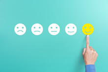 Client's Hand Picked The Happy Face Smile Face, Customer Service Evaluation And Satisfaction Survey Concept. Copy Space