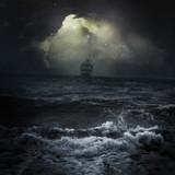 Fototapeta Fototapety z morzem do Twojej sypialni - Stormy sea ship in the distance romantic scene dark sky clouds Sun rays
