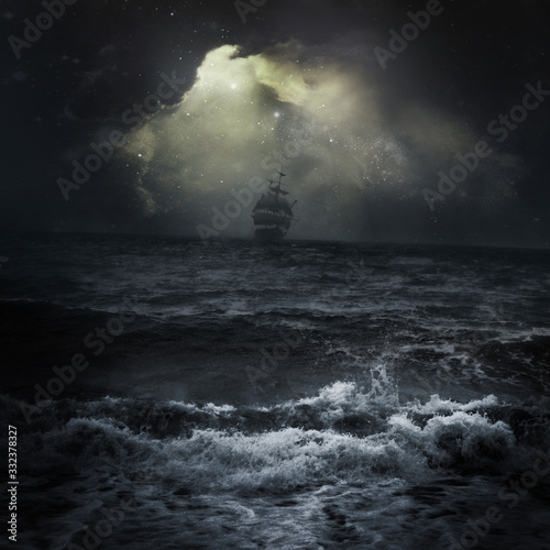 Obraz na plátně Stormy sea ship in the distance romantic scene dark sky clouds Sun rays
