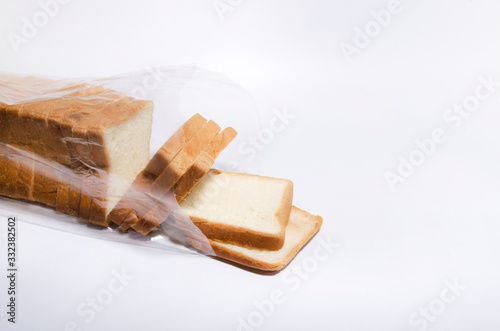 Cuadros en Lienzo Opened plastic bag full of slices of white bread on the white background
