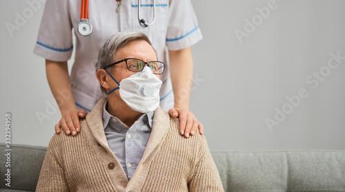 Doctor and senior man wearing facemasks