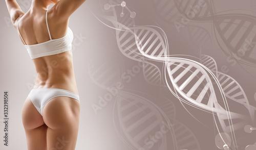 Fototapeta Sporty female body near DNA stems. Over beige background.