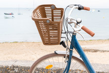 Fashionable Bicycle With Plastic Front Basket On The Handlebars By Sea Beach