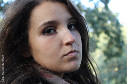 Young auburn beauty angry woman is looking to camera Canvas Print