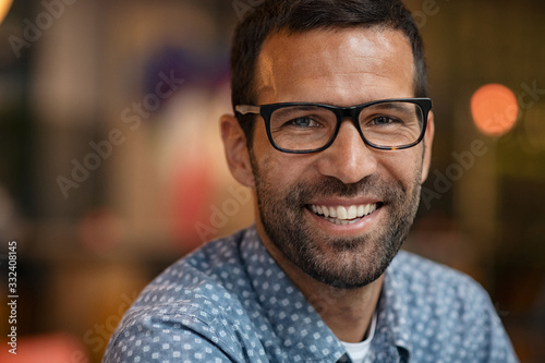 Obraz Portrait of smiling man looking at camera - fototapety do salonu