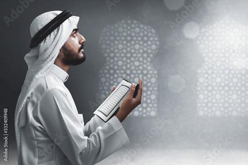 Religious arab muslim man reading holy quran Canvas Print