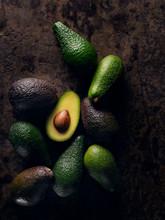 Half Avocado On Group Of Avoca...