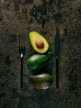Avocados With Black Cutlery