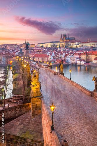 Prague, Czech Republic. Aerial cityscape image of Prague with famous Charles Bridge and Prague Castle during beautiful sunset.