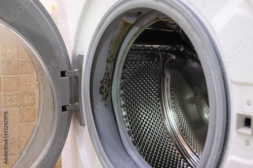 Fototapeta Mould on the seal washing machine in the bathroom. obraz