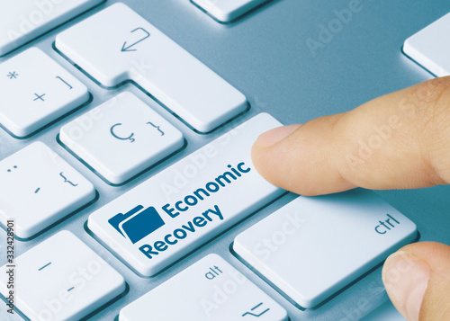 Foto Economic Recovery Blue: .- Inscription on Blue Keyboard Key.