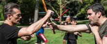 Large Group Of Students Practice Filipino Eskrima Stick Fight Techniques