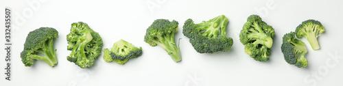 Fototapeta Flat lay with broccoli on white background, top view obraz