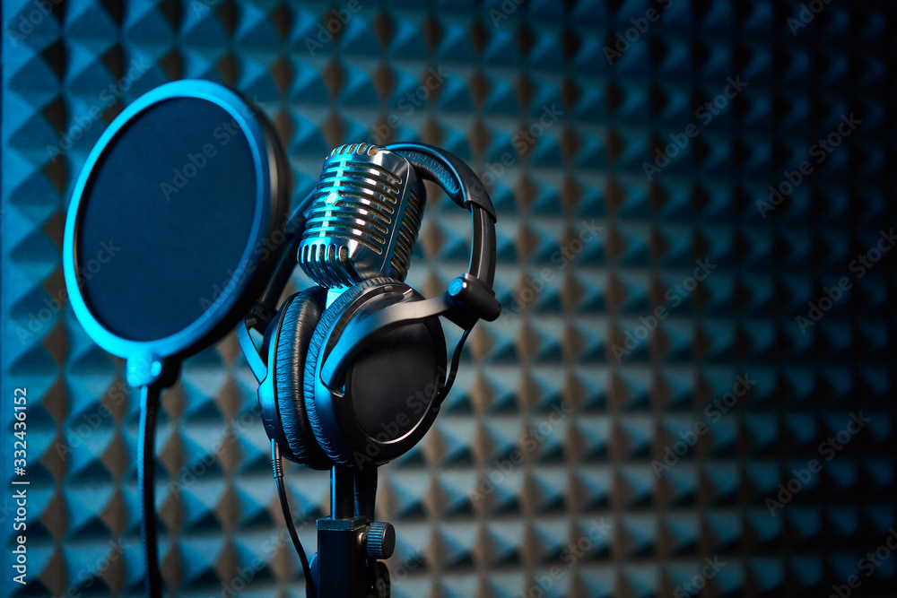 Fototapeta Retro microphone and pop filter on acoustic foam panel background