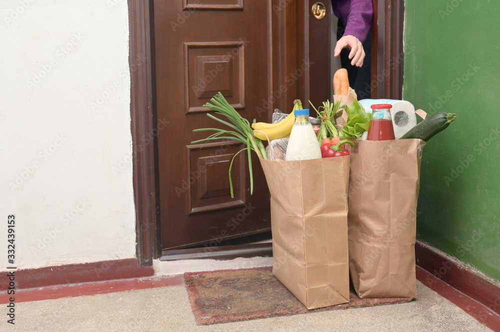 Fototapeta Delivering Food To A Self-isolate Woman