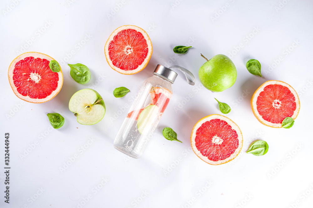 Fototapeta Balanced nutrition diet, fitness lifestyle concept. Fresh infused drink in glass jar. Detox water, lemonade with grapefruit and green apple.Top view flat lay background