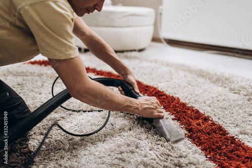 Process of deep carpet cleaning, dirt removing. Fotobehang