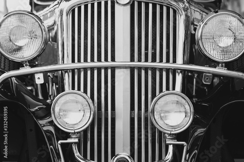 Stampa su Tela Close up front headlights with sparkle chrome of the old vintage classic car in